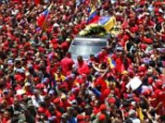 Tens of thousands of 'Chavistas' dressed in revolutionary red line streets to witness Hugo Chavez's coffin carried through streets